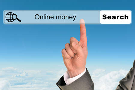money online: Businessmans hand on blue sky background with words online money in browser
