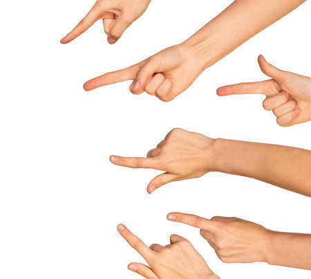 arm: Several pointing hands on isolated white background, close-up view