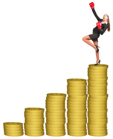 businesslady: Businesslady in boxing gloves and winning posture standing on gold coins stack. Isolated white background