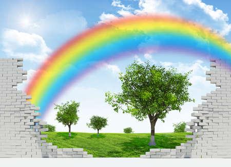 pared rota: Paisaje con el arco iris, el campo verde y los árboles en la pared rota Foto de archivo