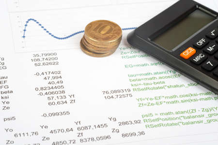 graphical: Documents with graphical charts and numbers, calculator and money Stock Photo