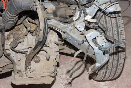 closeup view: Dirty wrecked car with wheels, close-up view