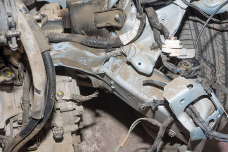 Dirty crashed car with wheels, close-up view Stock Photo