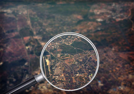 closeup view: Cityscape under magnifier, close-up view, nature background