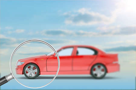 Red car under loupe on nature blue sky background
