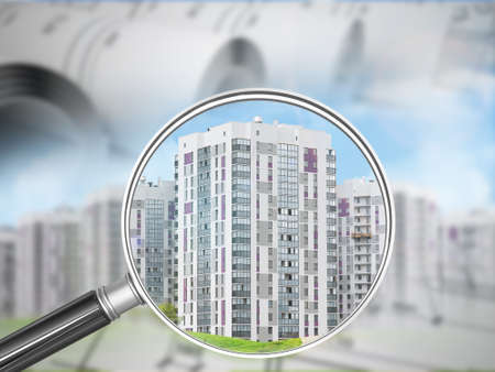 drafts: Buildings under magnifier with drafts on nature landscape background Stock Photo