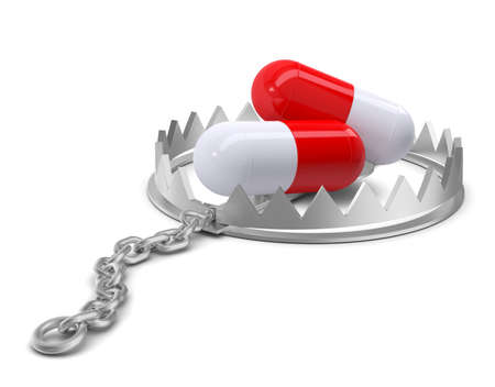 bear trap: Pills in bear trap on isolated white background, close-up view Stock Photo