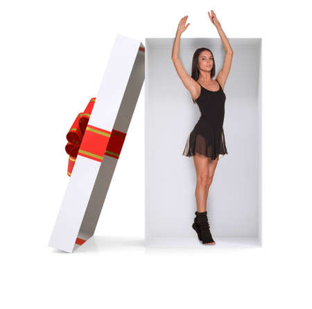 giftware: Ballerina in gift box with ribbon on isolated white background