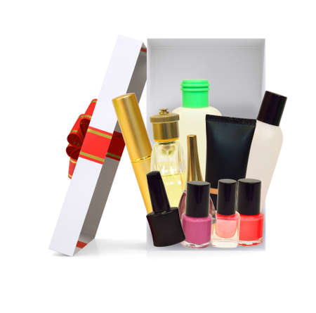giftware: Open gift box with ribbon and cosmetics on isolated white background Stock Photo
