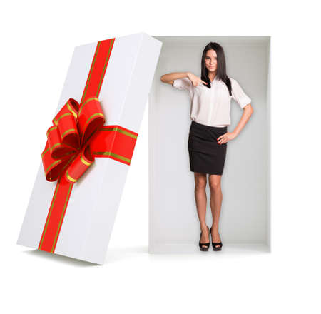 businesslady: Businesslady looking at camera in gift box with ribbon on isolated white background