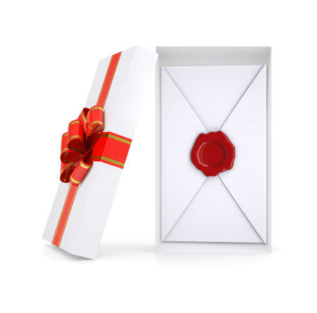 giftware: Envelope in gift box with ribbon on isolated white background