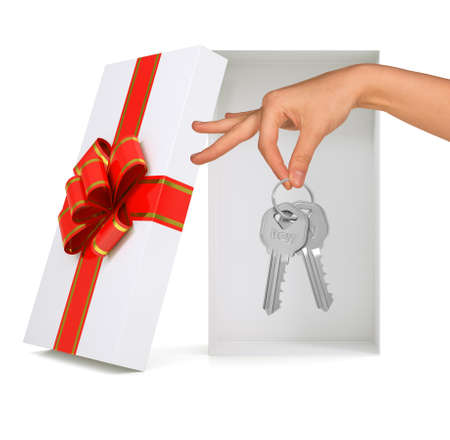 gold gift box: Open gift box with ribbon, hand and keys on isolated white background