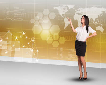businesslady: Businesslady pointing at map on abstract colorful background with world map Stock Photo
