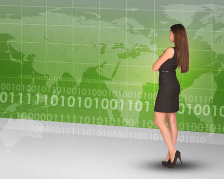 businesslady: Businesslady standing back and looking at world map Stock Photo