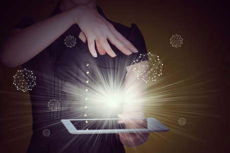 businesslady: Businesslady with tablet and spotlight on abstract background