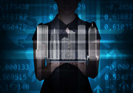 businesslady: Businesslady with tablet and 3d city model on abstract blue background