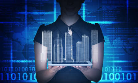 Businesswoman holding tablet and 3d city model on abstract blue background