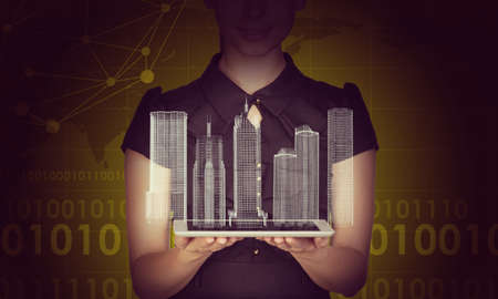 businesslady: Businesslady holding tablet and 3d city model on abstract colorful background
