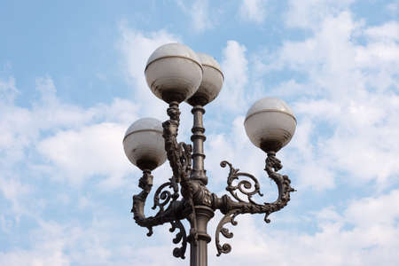 plafond: Street lamp on blue sky background with clouds