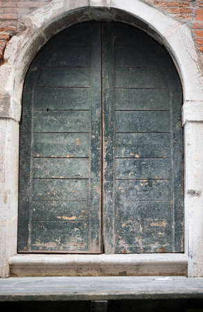 front view: Wooden arched door in house with doorsteps, front view Stock Photo