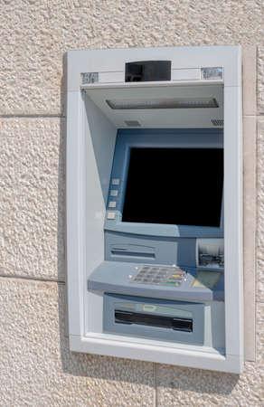 cash machine: Cash machine in building wall with screen