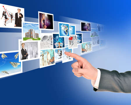 holographic: Businessmans handwith holographic pictures on abstract background