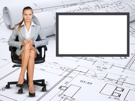 Business lady sitting in chair with crossed legs on abstract background with empty square shape place Stock Photo