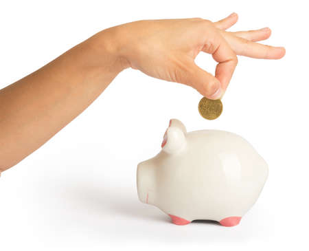 white piggy bank: Piggy bank with humans arm on isolated white background, close up view