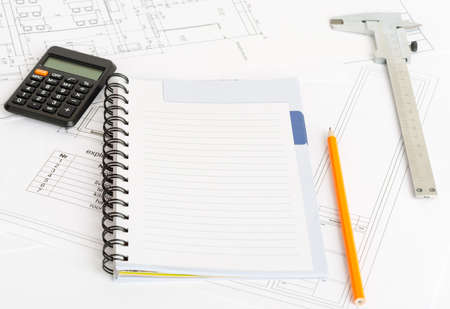 exercise book: Drafts and exercise book with calculator and ruler Stock Photo