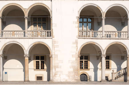 arched: White building with arched shape balconies and stairs Stock Photo
