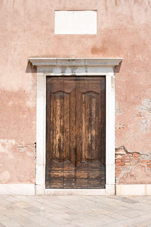 front view: Wooden doors in old-fashioned house, front view Stock Photo