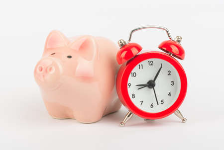 solated on white: Red alarm clock with piggy bank solated white background