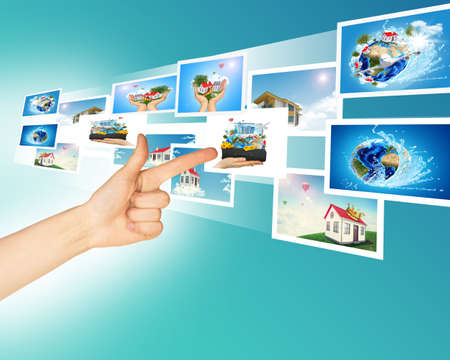 holographic: Arm with holographic pictures on abstract background Stock Photo