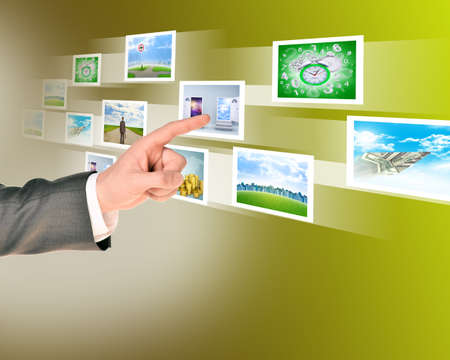 holographic: Businessmans touching holographic pictures on abstract background