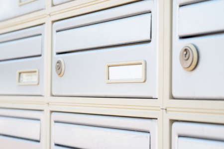 key holes: Letter boxes with key holes, close up view Stock Photo