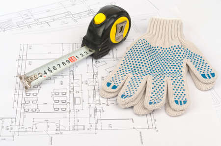 draft: Tape measure with gloves on draft background