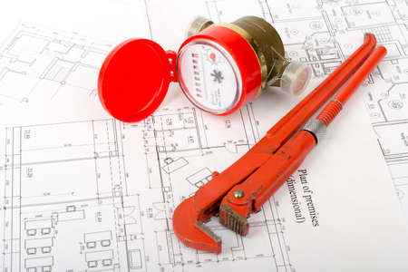 red water: Red water meter with wrench on draft background