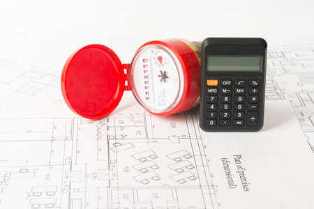 red water: Red water meter with calculator on draft background