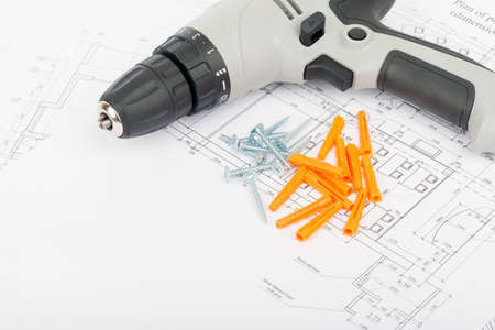 crimping: Screw gun on draft with crimping lug, close up view Stock Photo