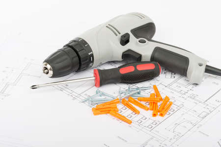 lug: Screw driver on draft with crimping lug, close up view Stock Photo