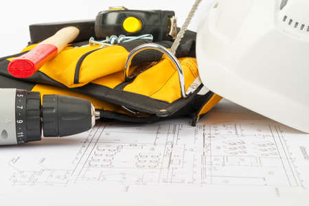 tool belt: Electric screwdriver with tool belt on draft background Stock Photo