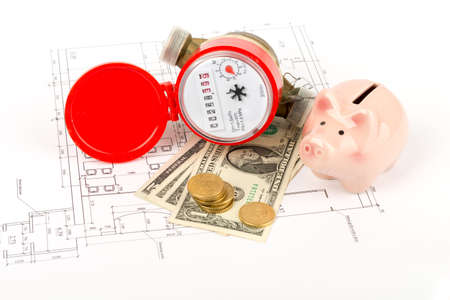 red water: Red water meter with piggy bank on draft background Stock Photo