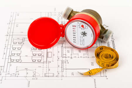 red water: Red water meter with tape-measure on draft background