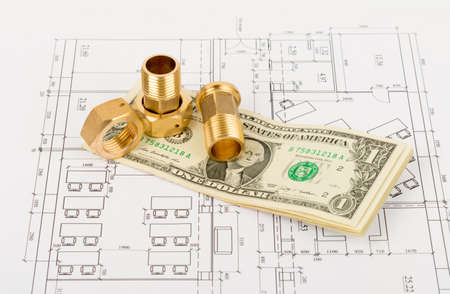 fittings: Metal pipe fittings with cash on draft background, close up view Stock Photo