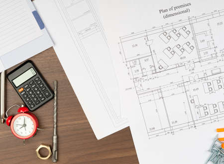 fittings: Drafts with alarm clock and calculator and pipe fittings on table