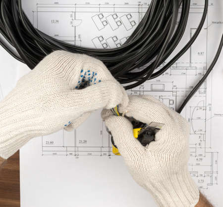 mans: Mans hands holding cable on draft background