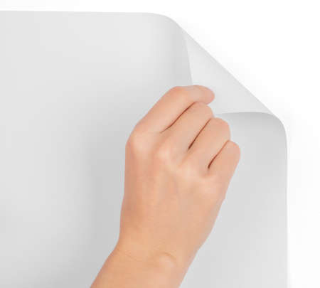 blank page: Hand turning blank page on isolated white background Stock Photo