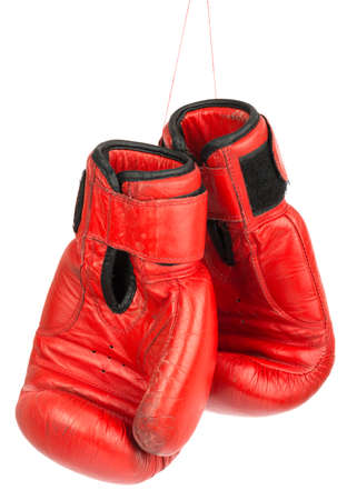 boxing knockout: Red boxing gloves on isolated white background Stock Photo
