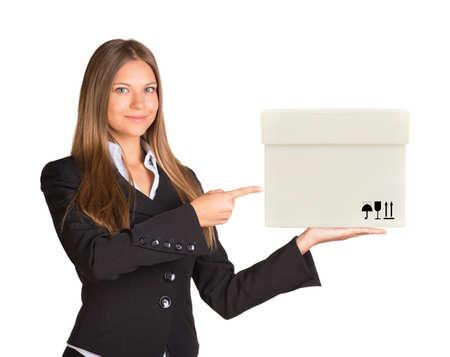 businesslady: Businesslady holding white box on isolated white background Stock Photo