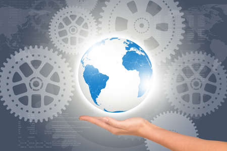 womans: Womans hand with planet on abstract background with cog wheels Stock Photo